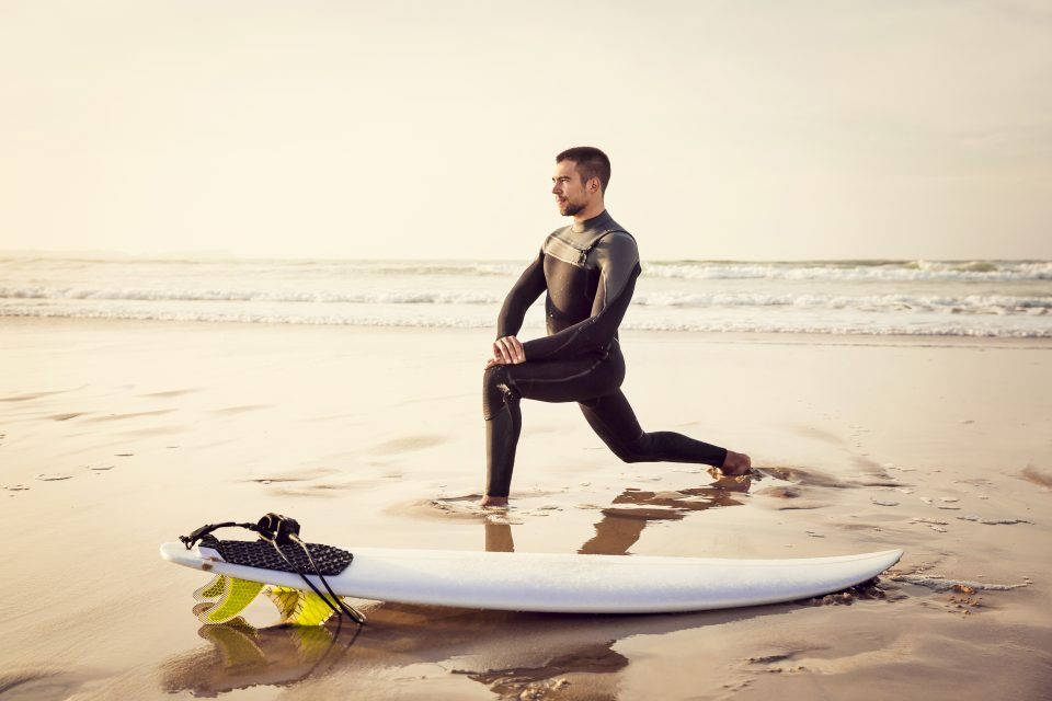 man stretching surf