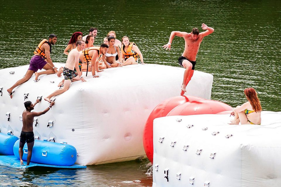 A group of people on an inflatable assault course