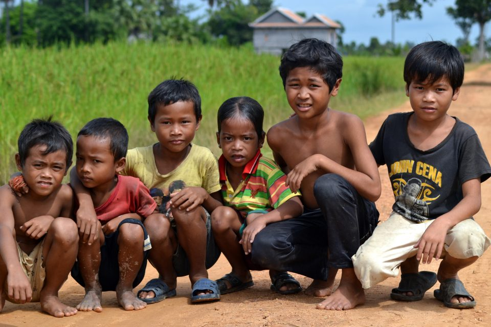 A group of local children crouching down