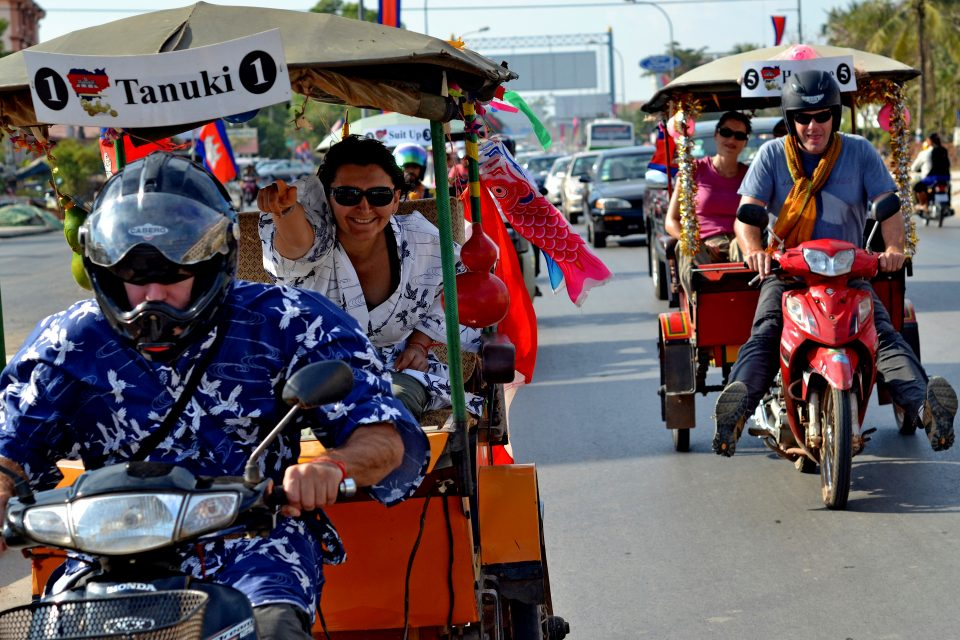 People racing in tuk tuks