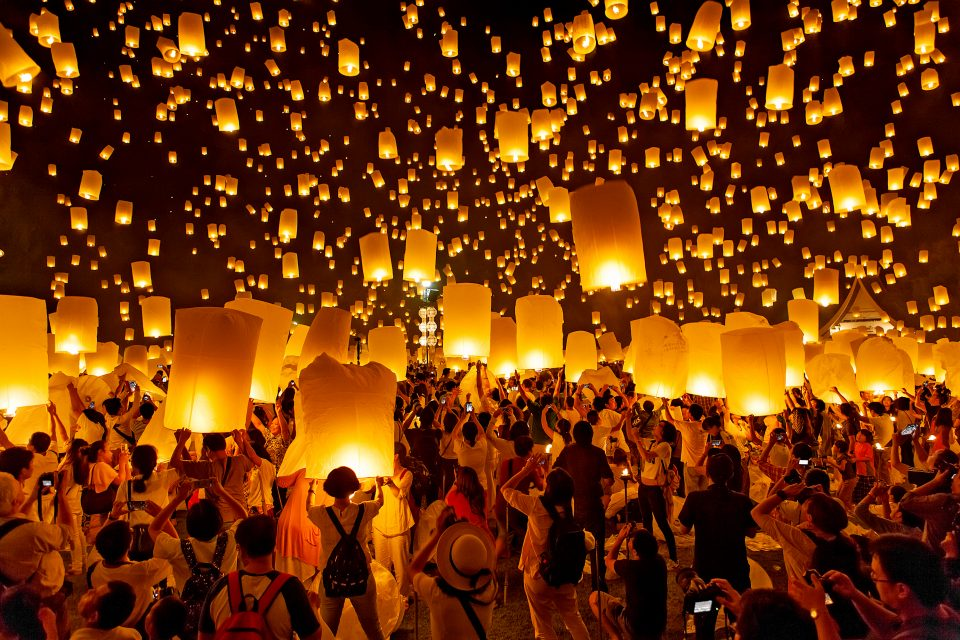 Multiple lanterns being let go into the sky