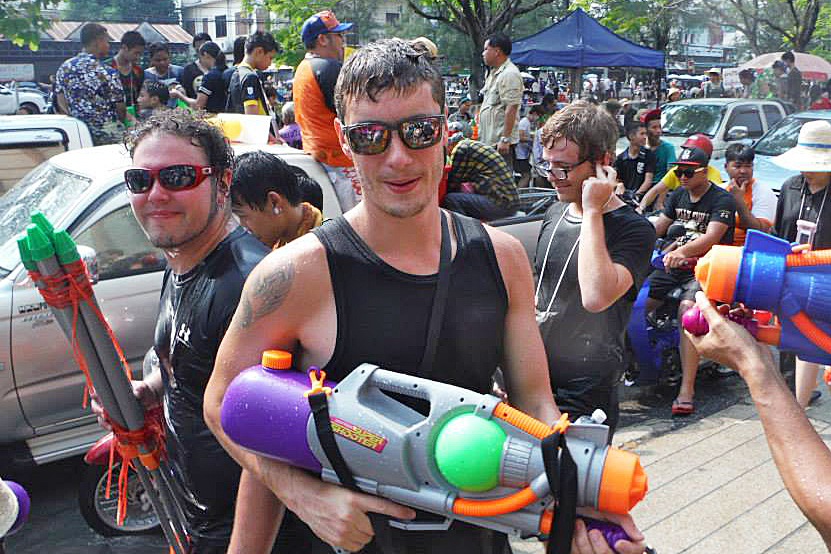 A group of people with water guns