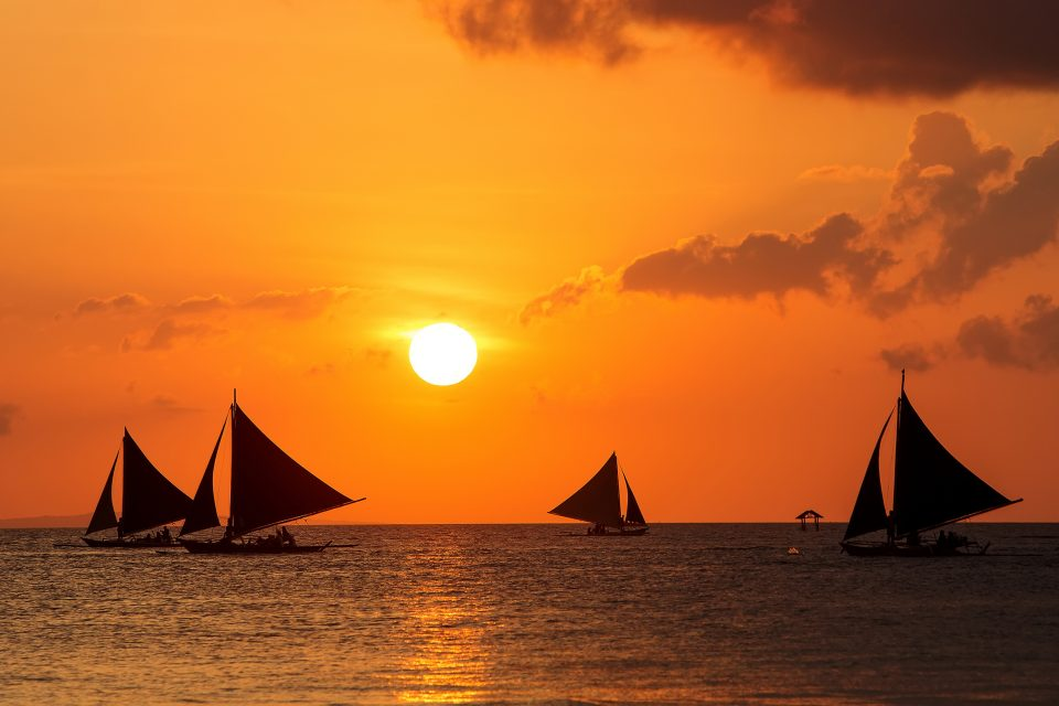 Sailboats on the sea at sunset
