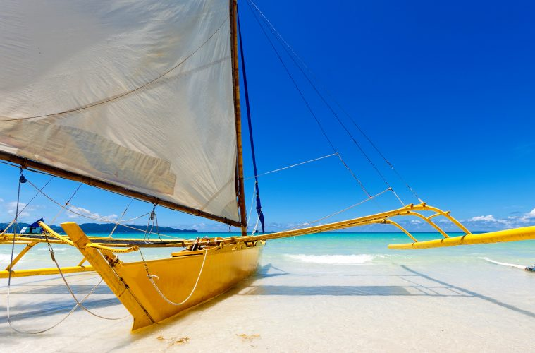 A sailboat moored on the beach