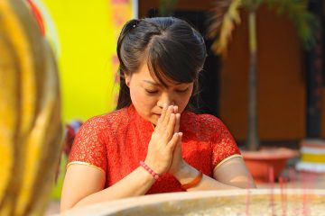 Close up of a woman praying