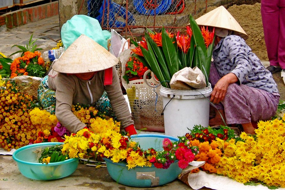 Local women selling flowers