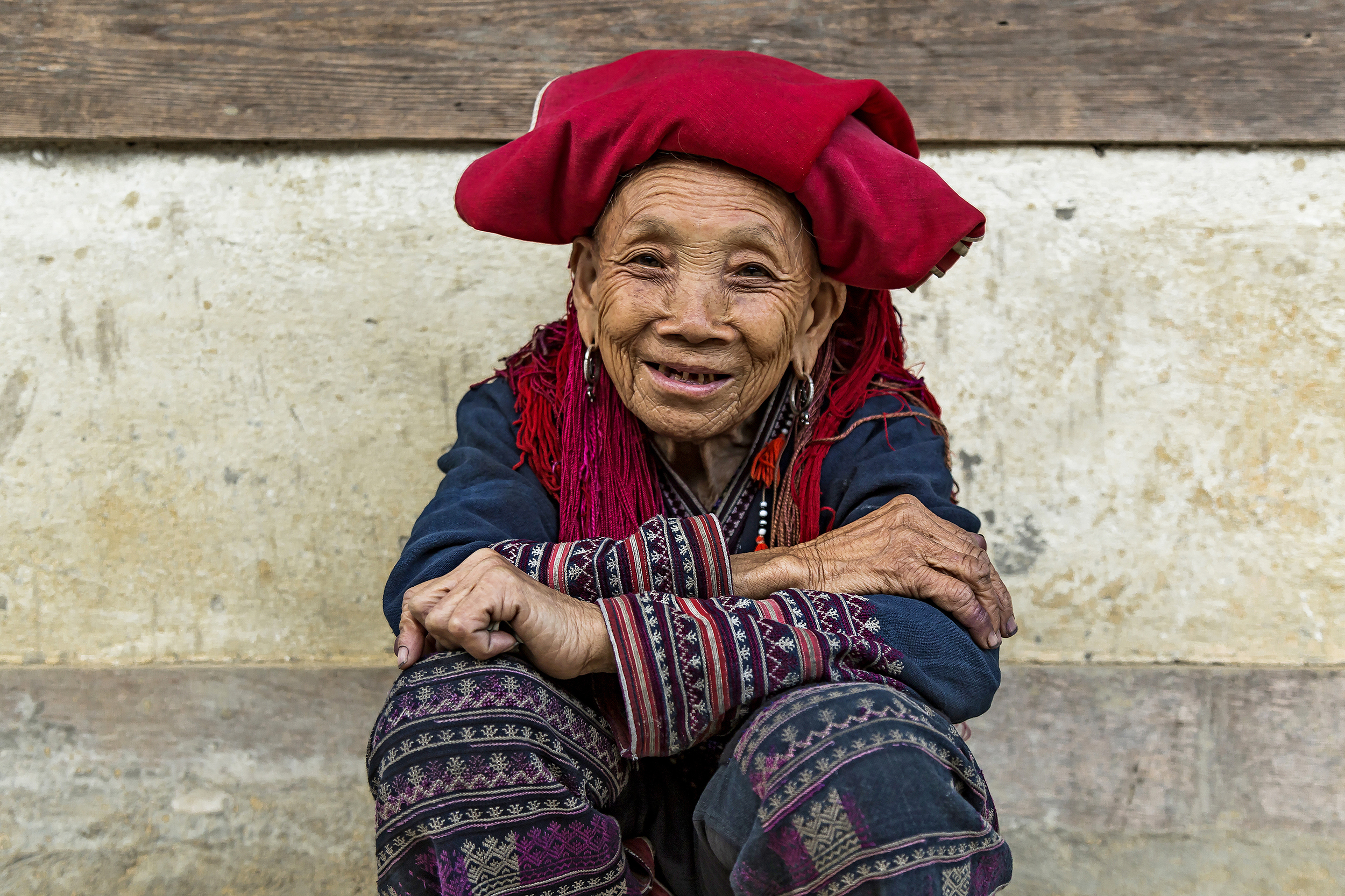 A local woman sitting and smiling