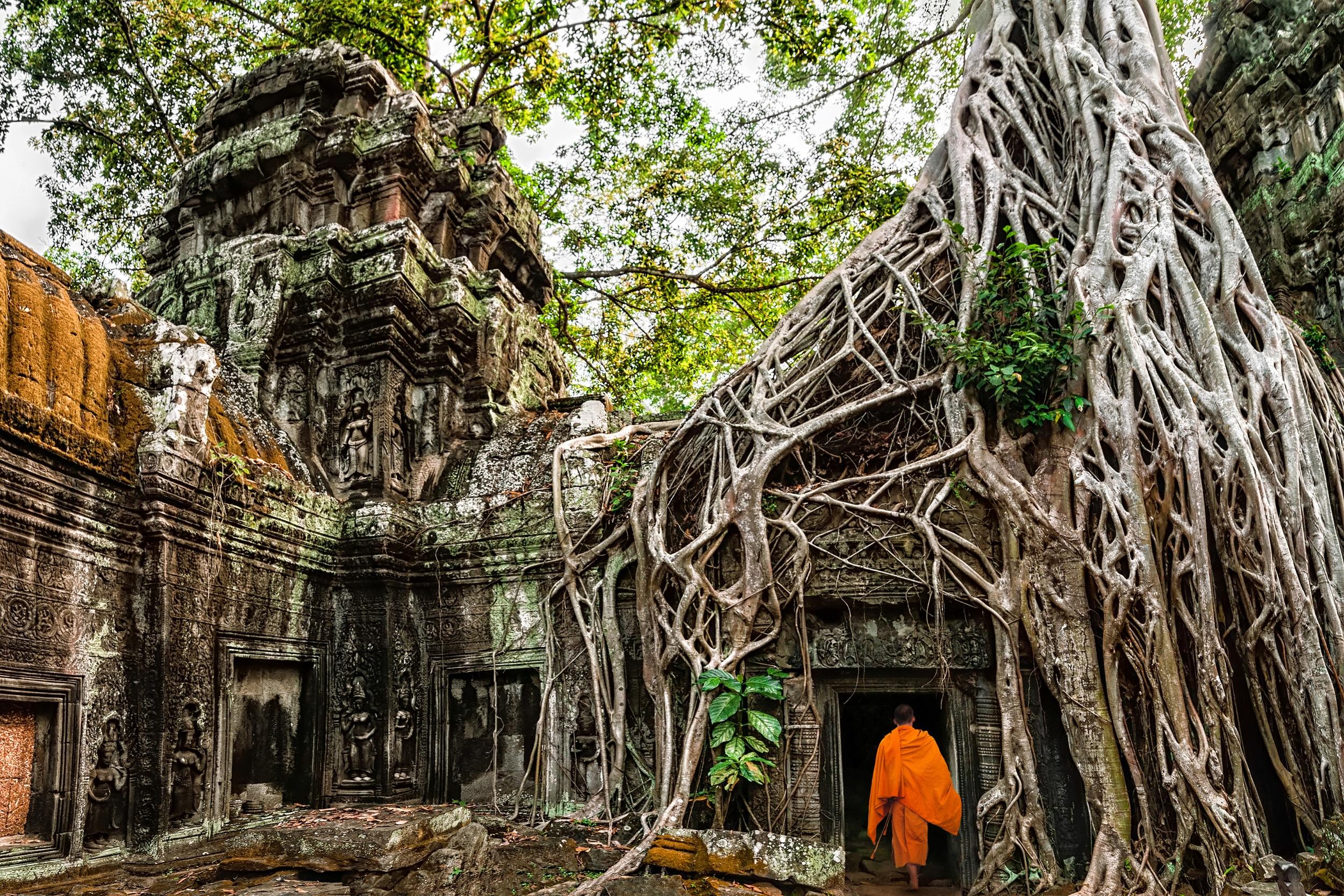 A monk walking through a stone temple