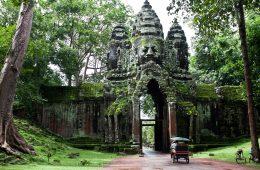 A tuk tuk driving through a temple