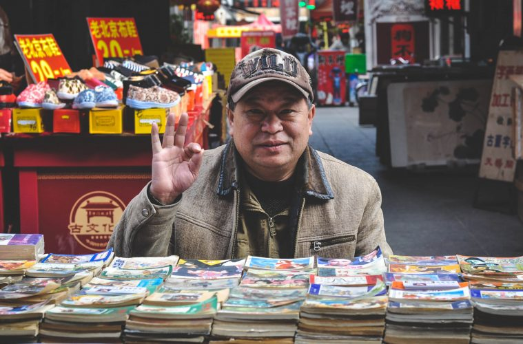 A local man sitting at a book stall