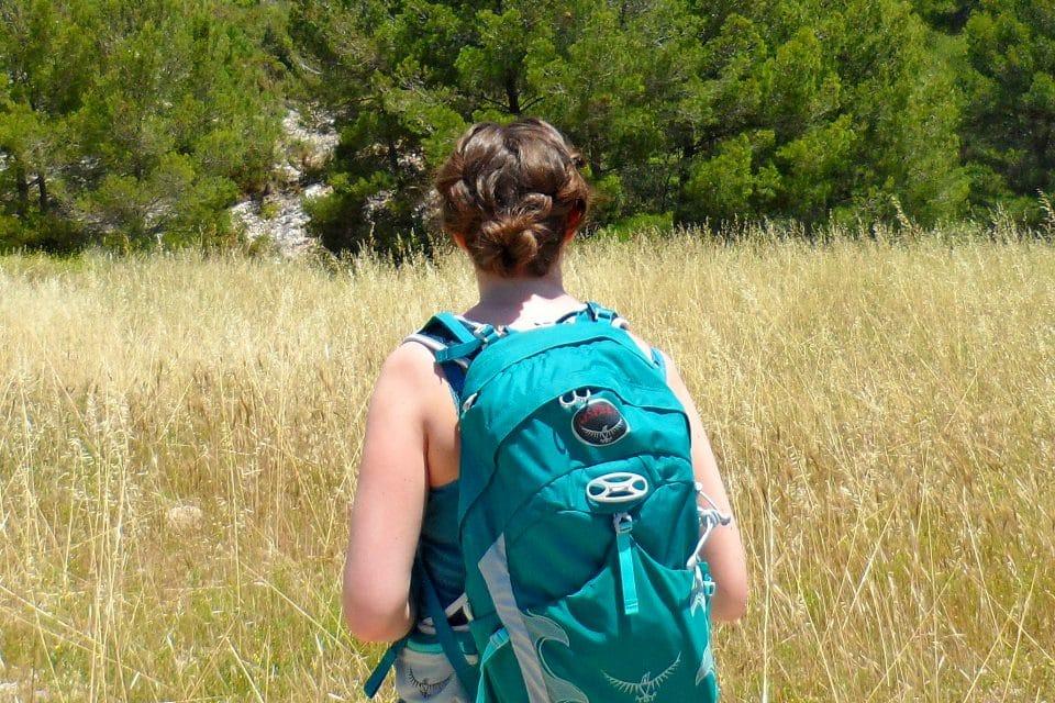 becky rogers wearing an osprey bag