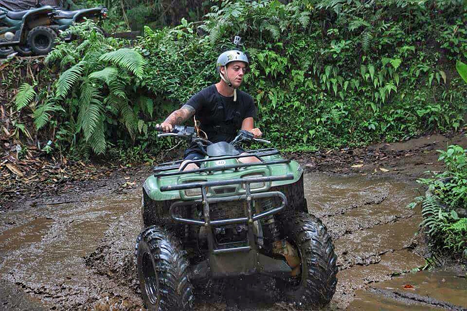 Charlie from wander lovers quad biking in Bali