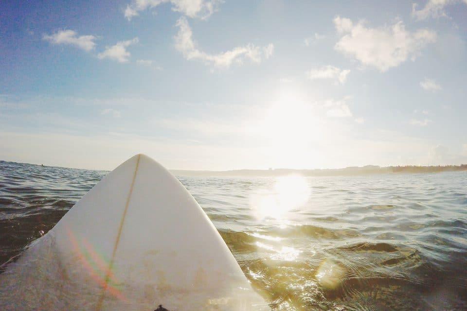 man surfboard ocean