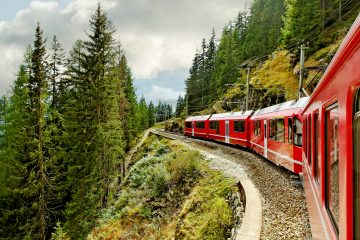 A red train on the mountain edge