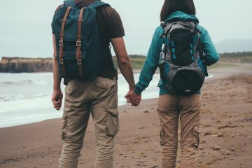 A couple holding hands on a beach