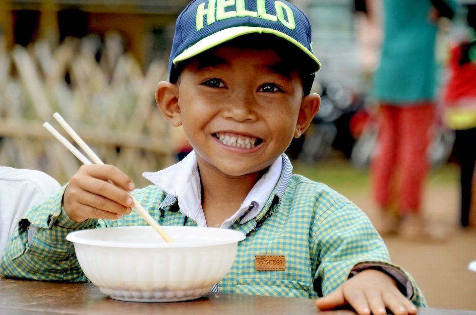 Vietnam kid eating noodles