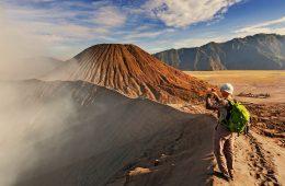 A man taking a photo of Mount Bromo