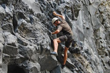 Tom rock climbing in Banos