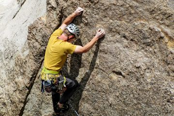 A man rockclimbing