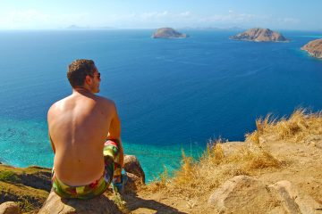 A man sitting overlooking the sea