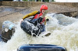 A woman on a tube on the rapids