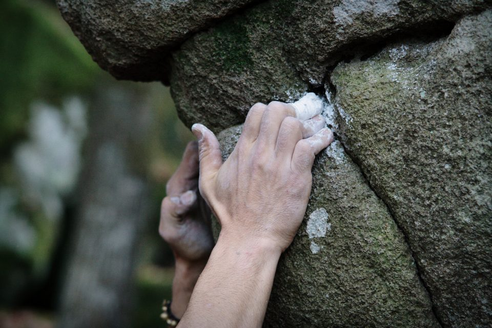 Close up of hands bouldering