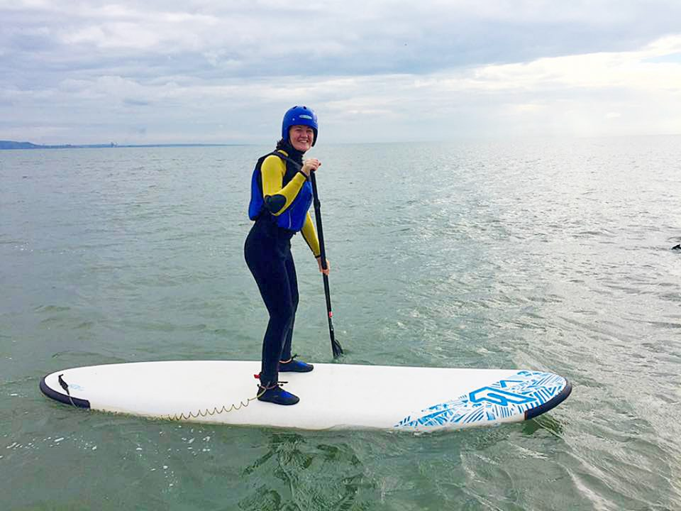 A woman paddleboarding