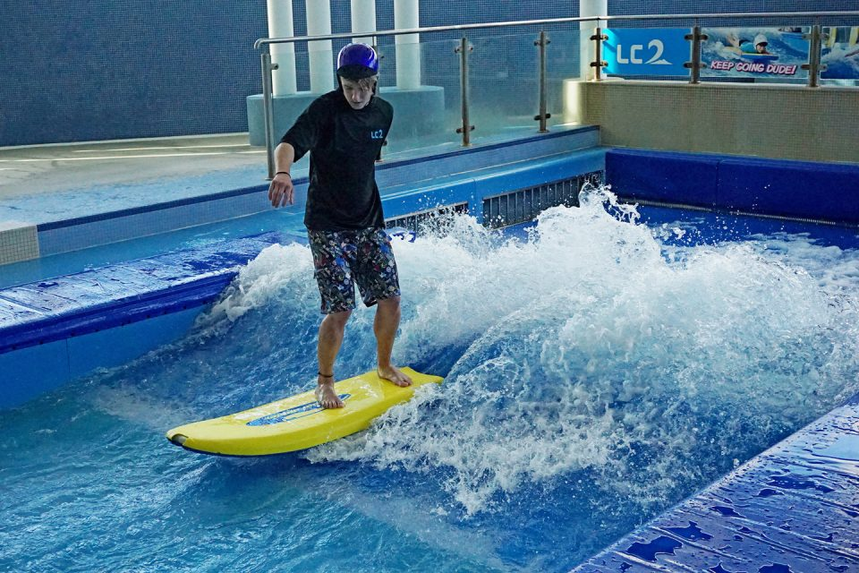 A man indoor surfing
