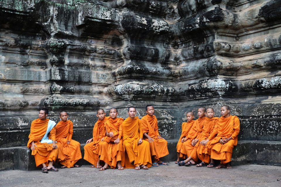 A group of monks sitting down