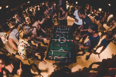 crowd playing foosball