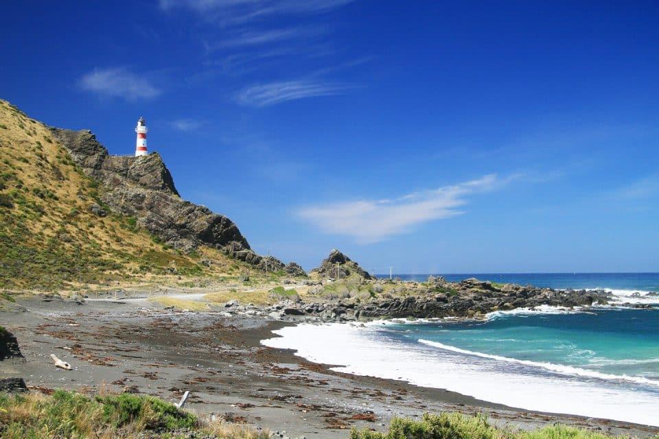 A lighthouse on a rocky cliff