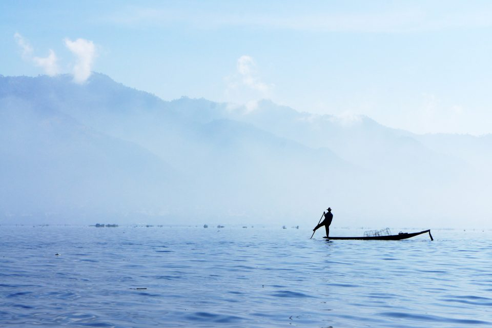 Fisherman on a boat in Lake Inle in Myanmar