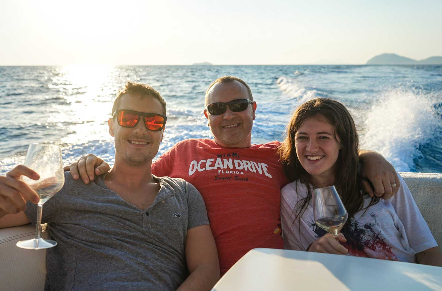 father, son, and daughter on a boat
