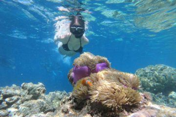 girl snorkeling with mask and snorkel