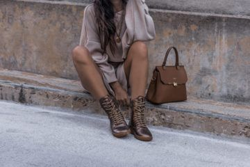 Woman sitting on steps next to her purse