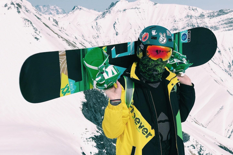 guy holding snowboard