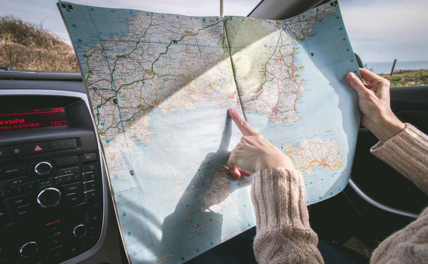 road trip looking at map