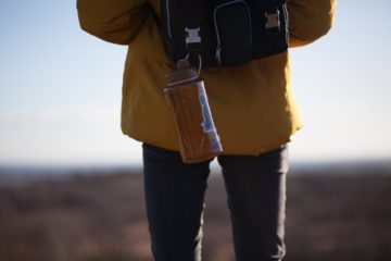 Water bottle hanging off of backpack