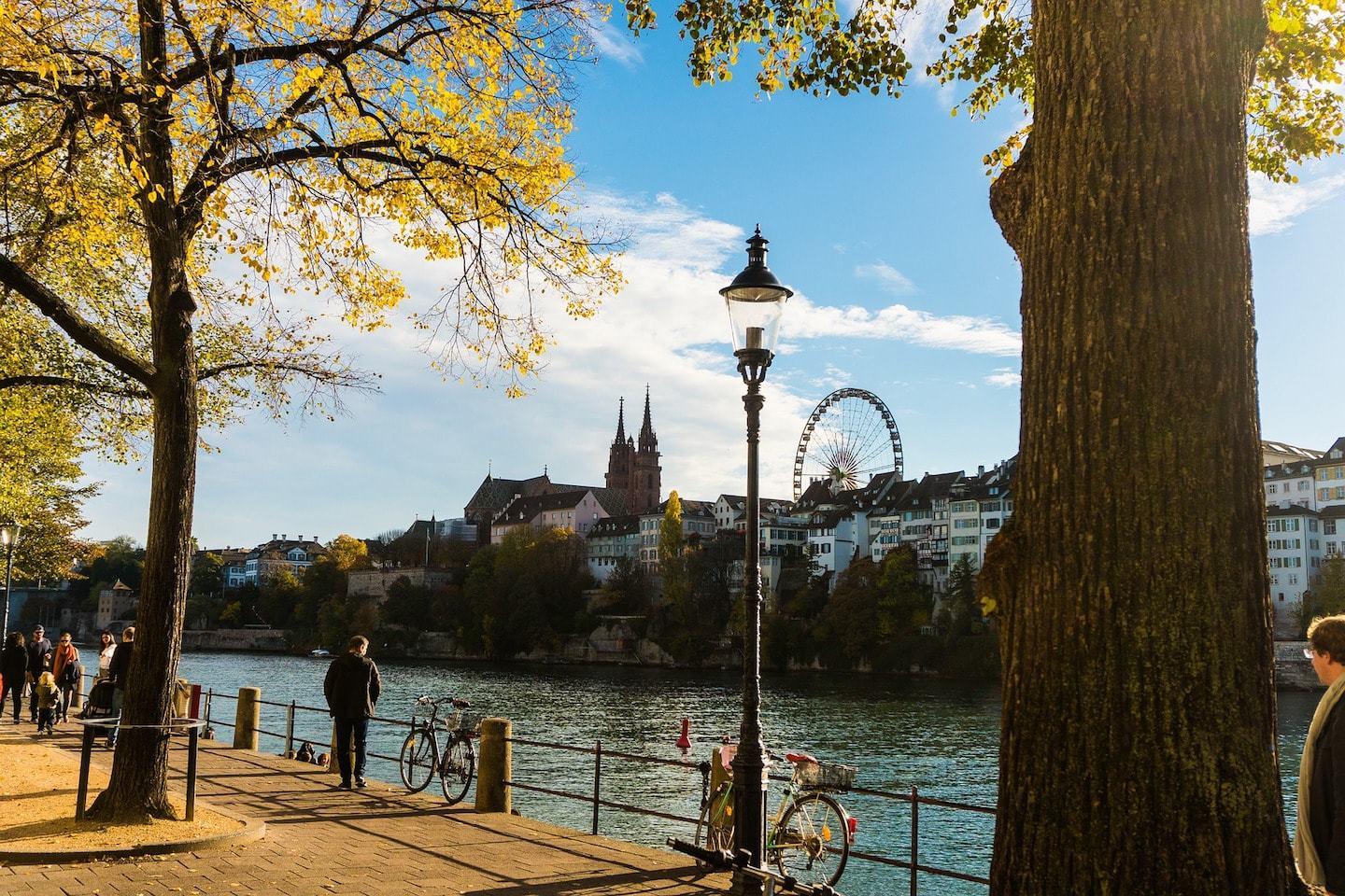 promenade with ferris wheel and towers in basel switzerland
