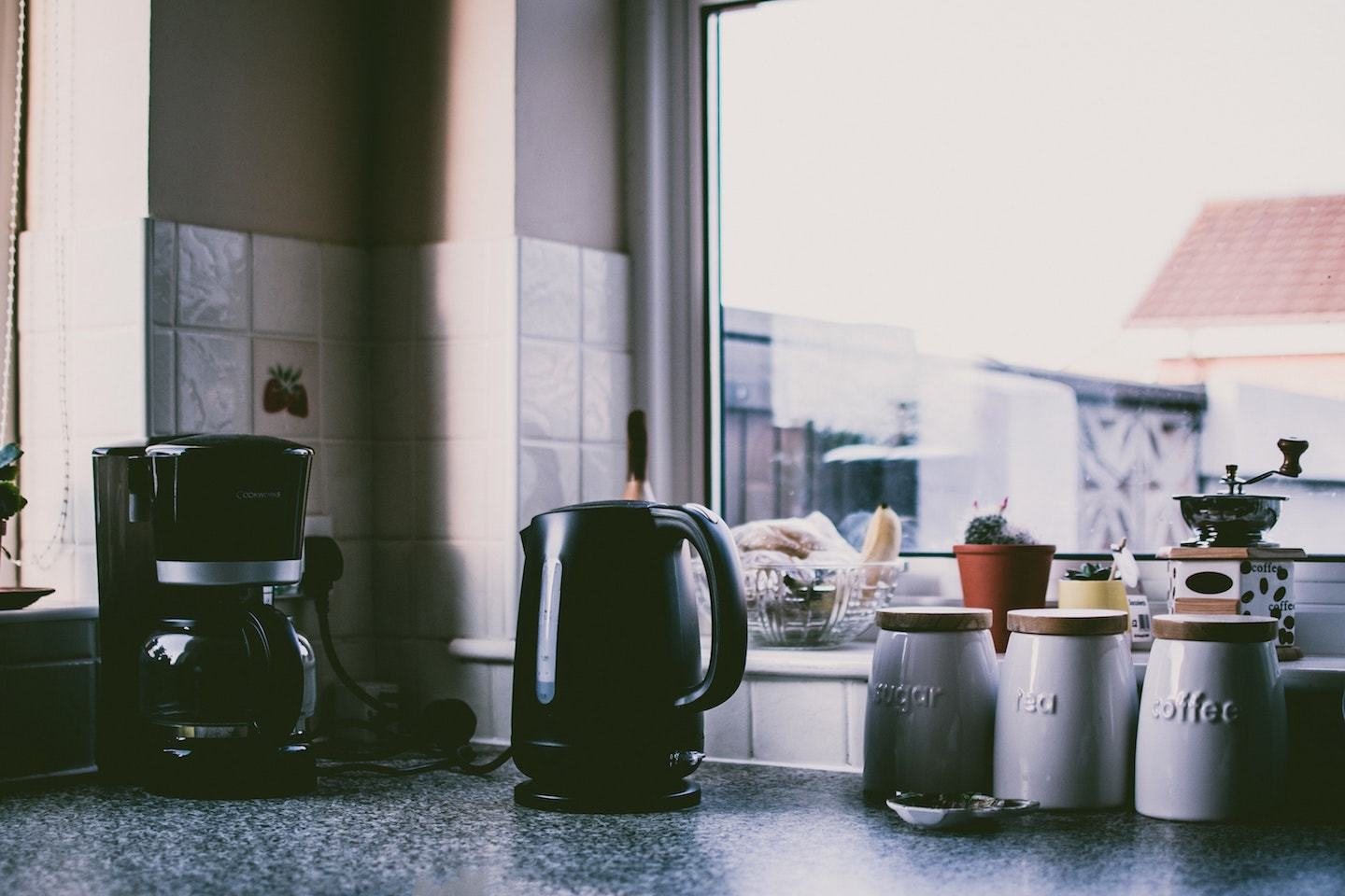 coffee maker and tea kettle on kitchen counter