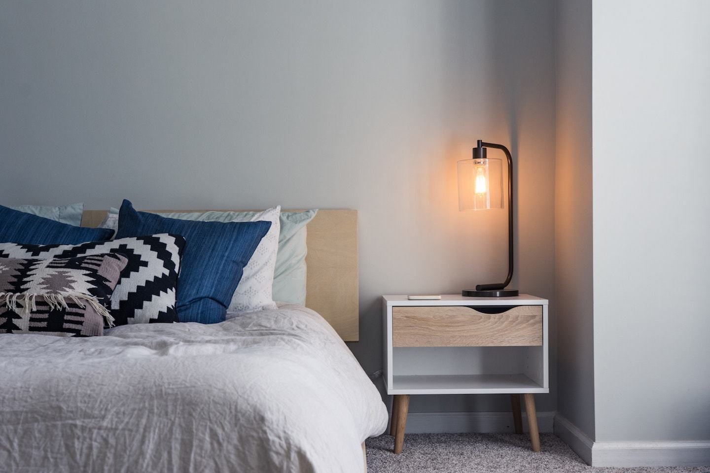 bed with side table and lamp