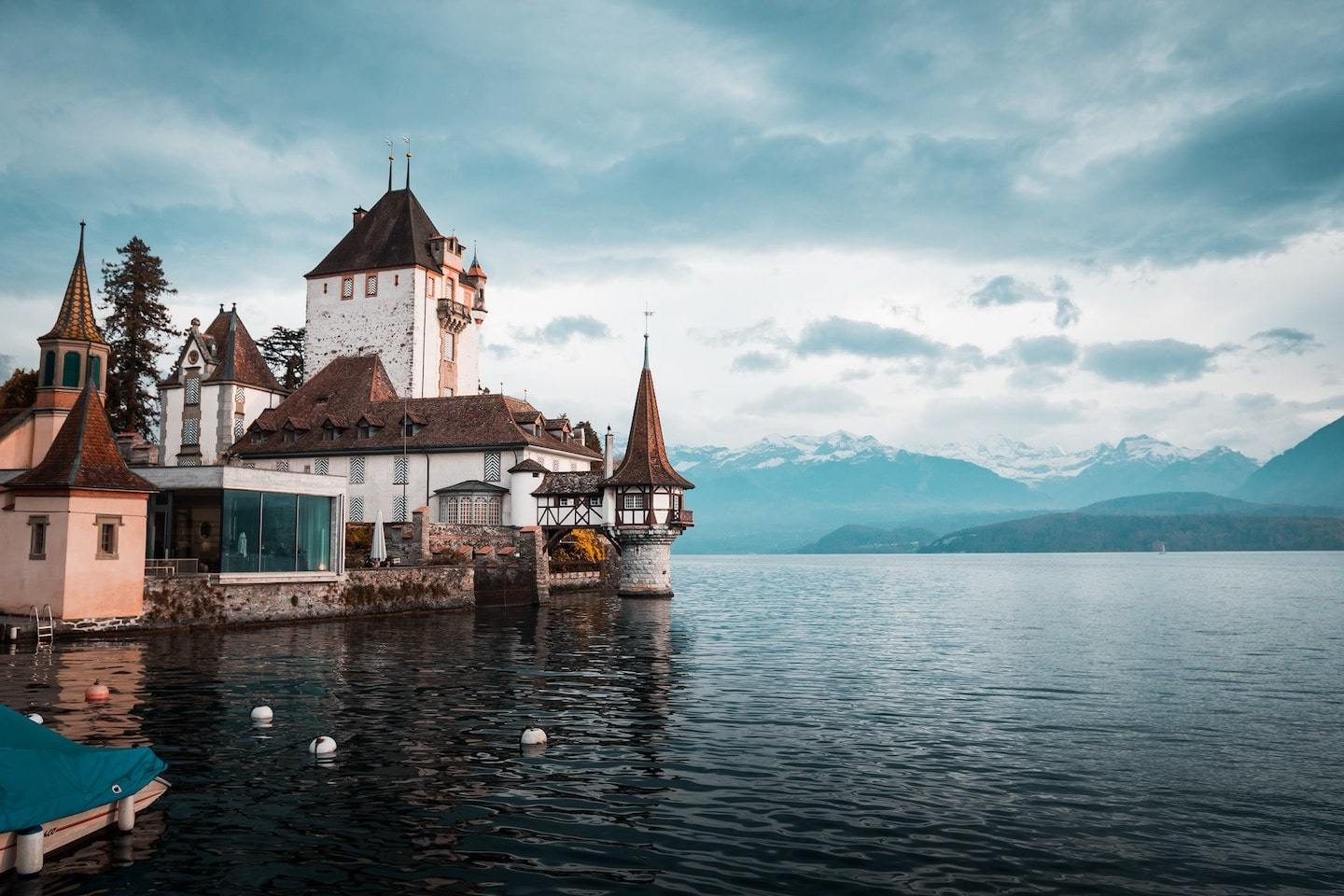 view of Oberhofen Castle interlaken with water