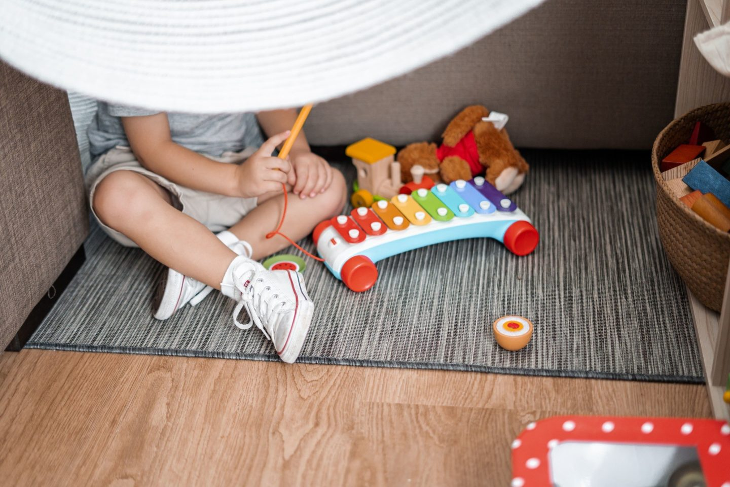 kid hiding playing xylophone