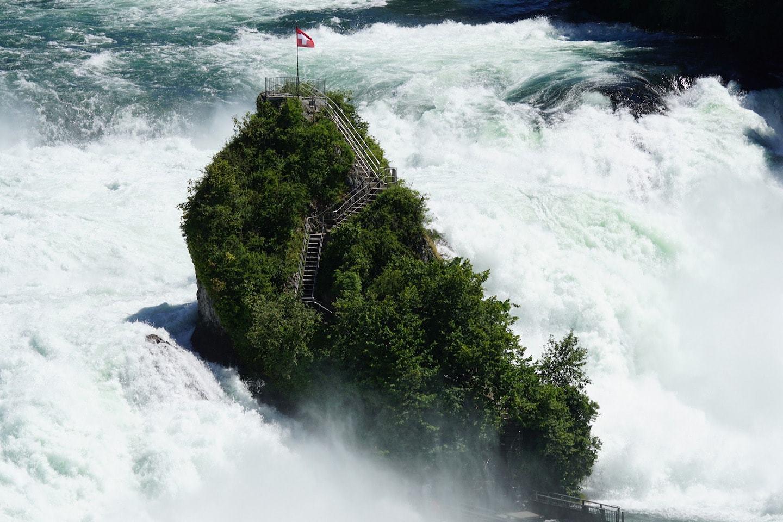rushing water over rock at rhine falls switzerland