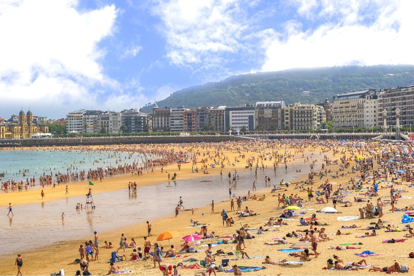 people at the beach in San Sebastian