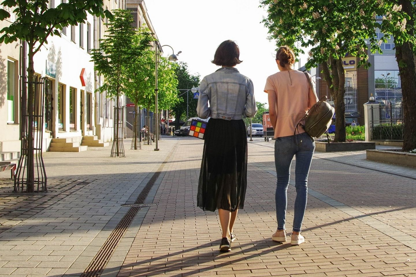 ladies walking in a city