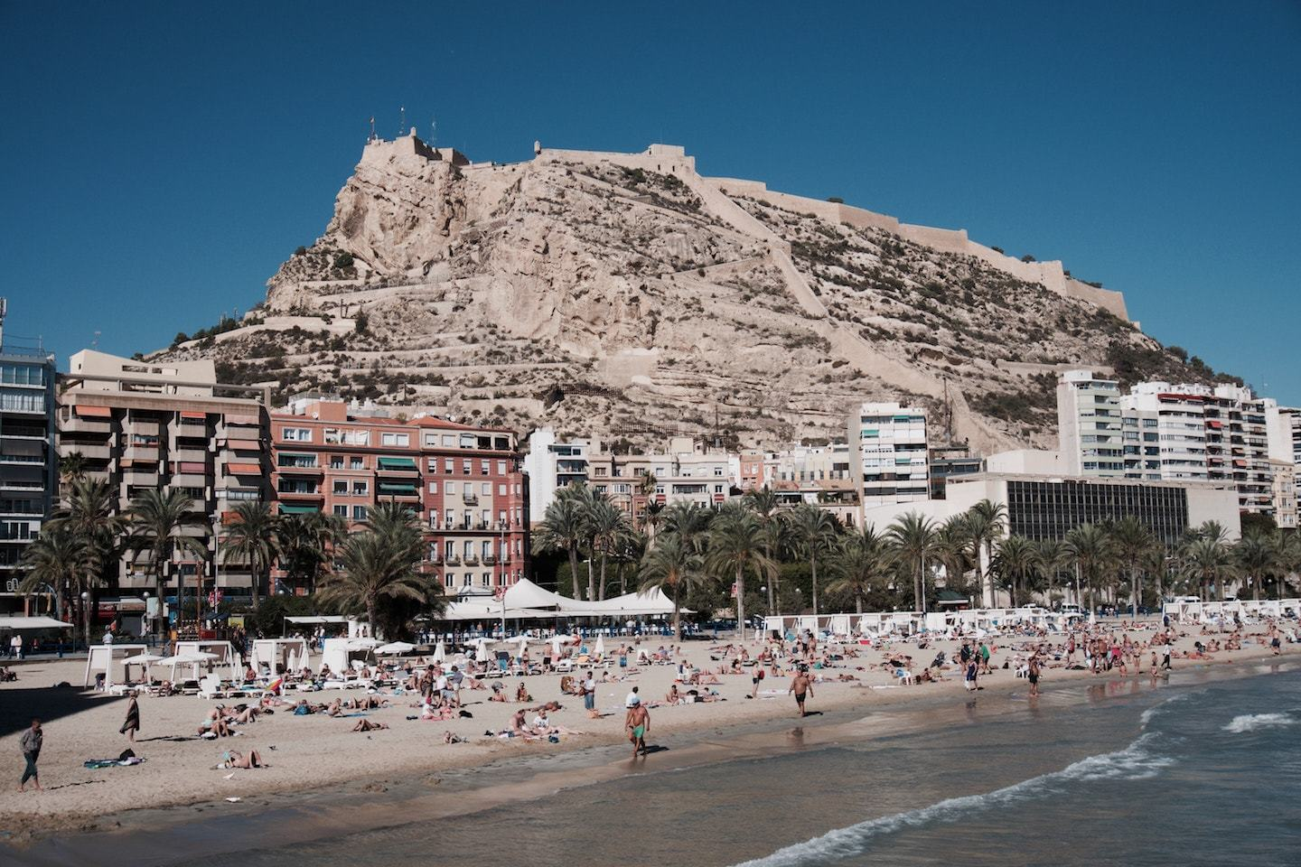 beach surrounded by mountain and buildings in alicante spain