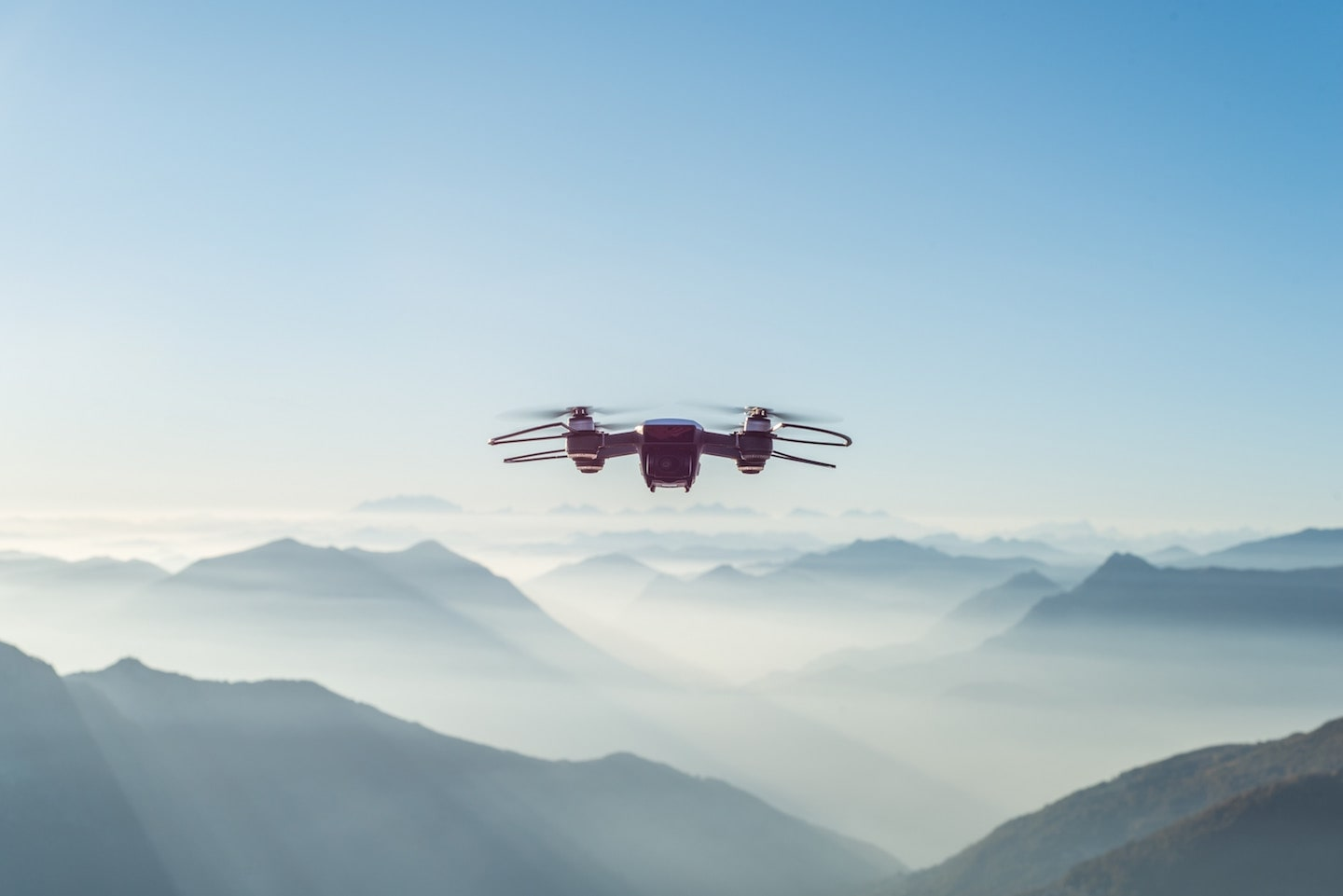 drone in mountains and clouds