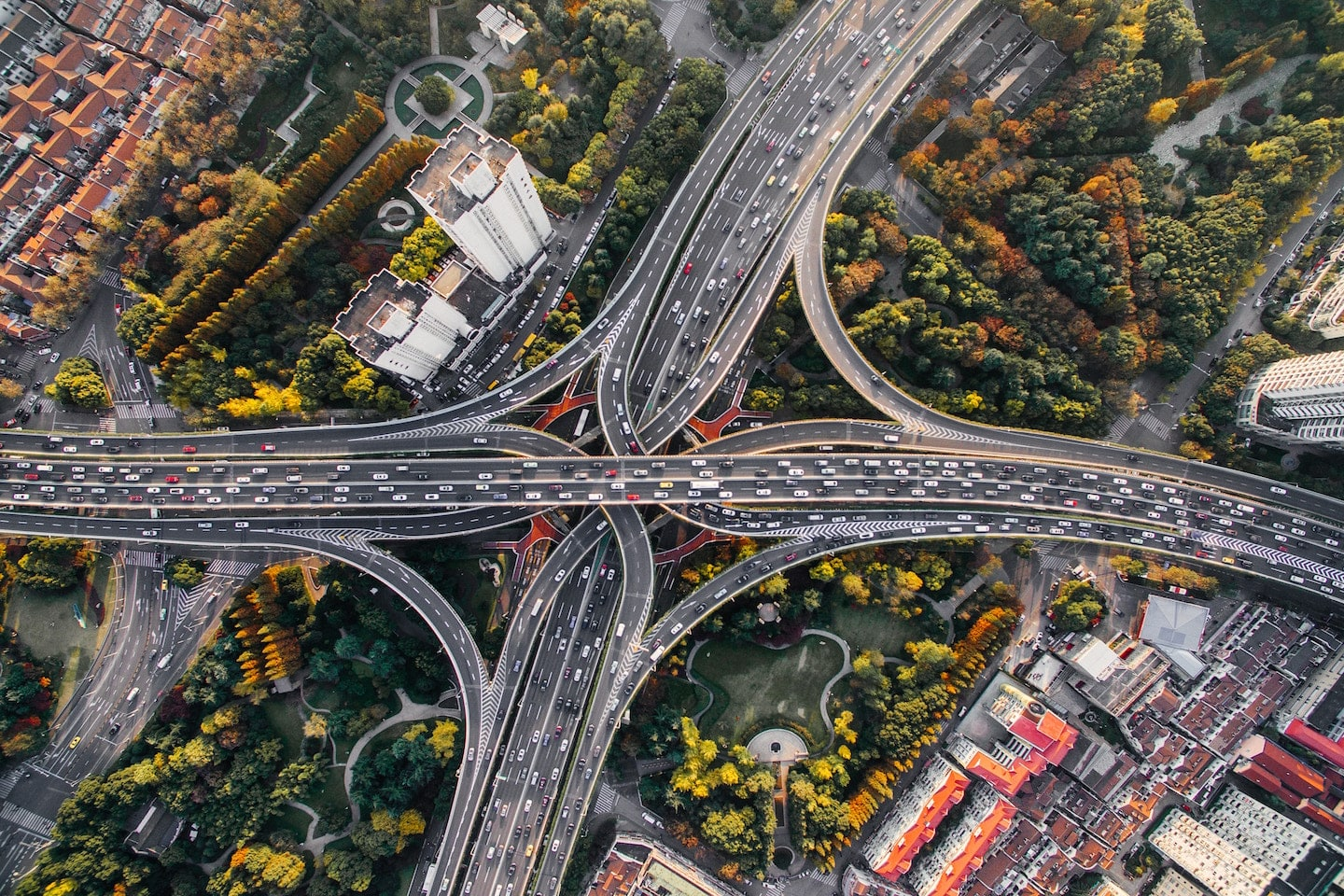 aerial view of city highways and moving traffic