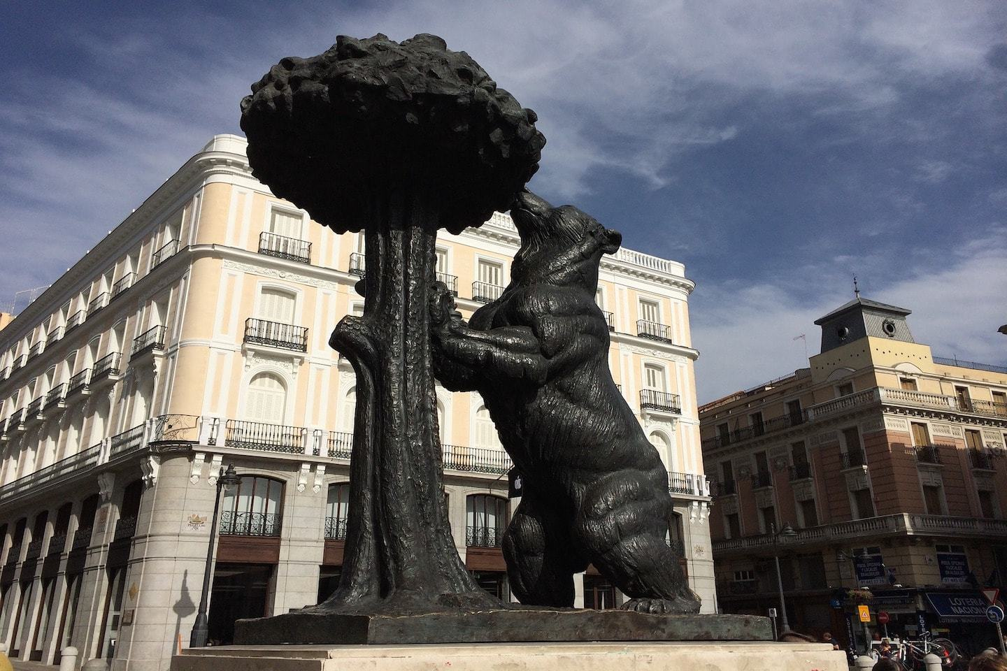 statue of a bear eating out of a tree in madrid spain